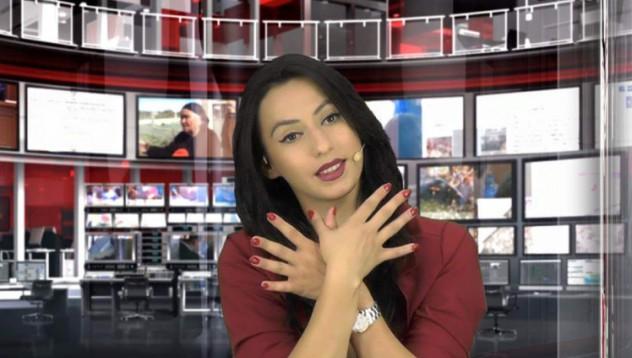Тази албанска телевизионна водеща ще спечели сърцето ви